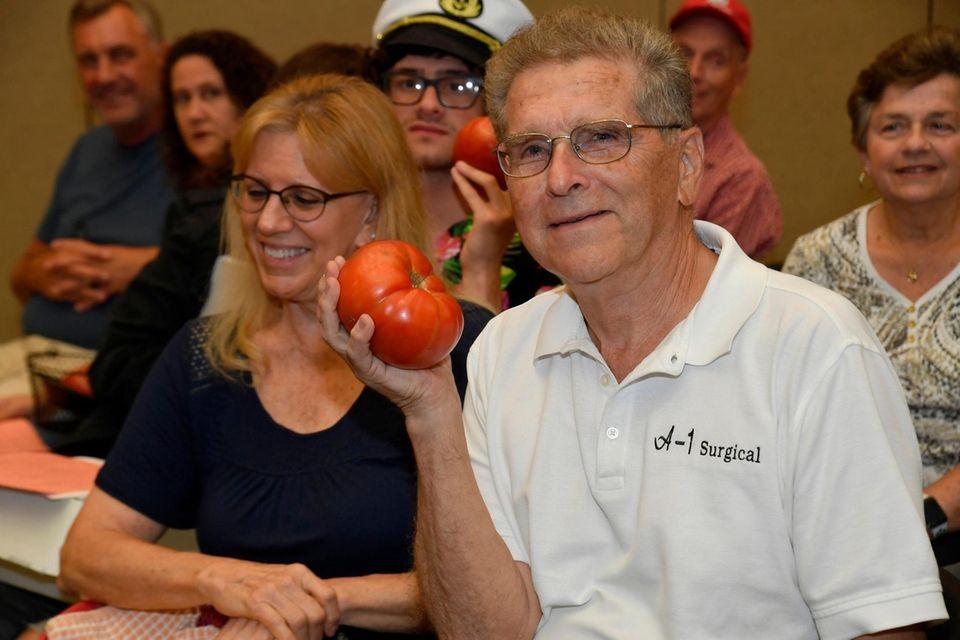 Tony Corsentino of Mineola shows off his tomato
