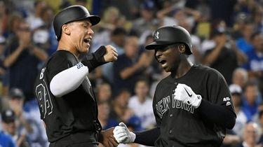 Aaron Judge #99 of the Yankees congratulates Didi