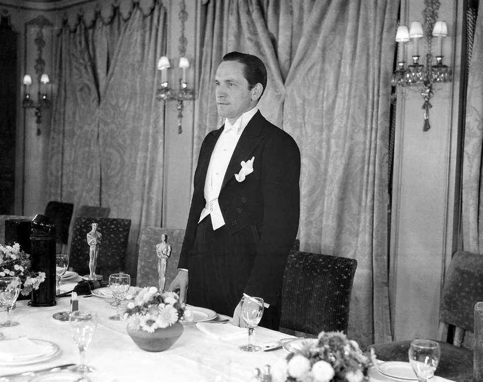Fredric March, acknowledging applause during the fifth annual