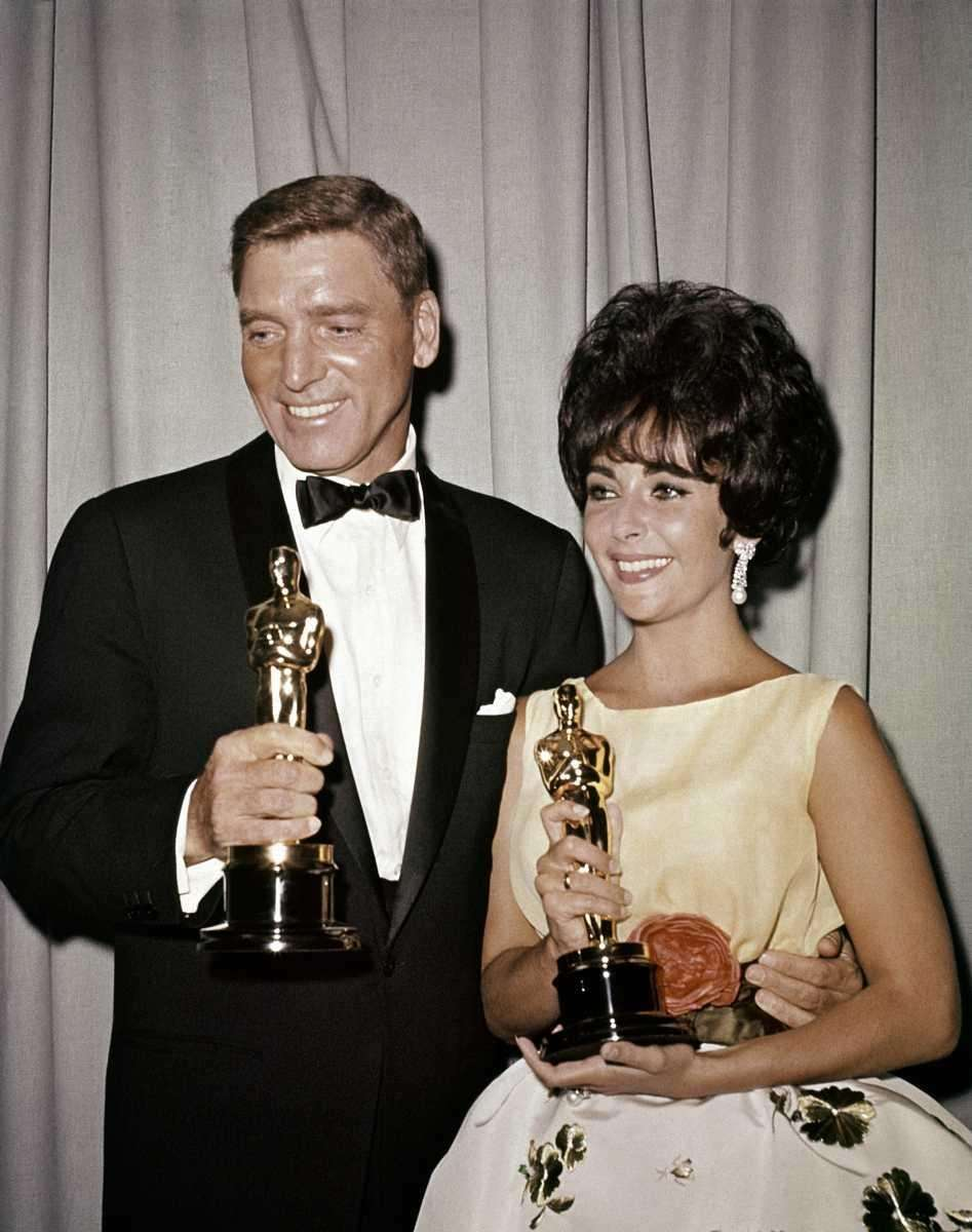 Actors Elizabeth Taylor (left) and Burt Lancaster (right),