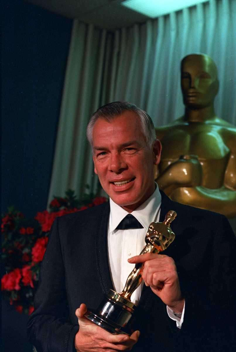 Actor Lee Marvin poses with his Oscar statuette