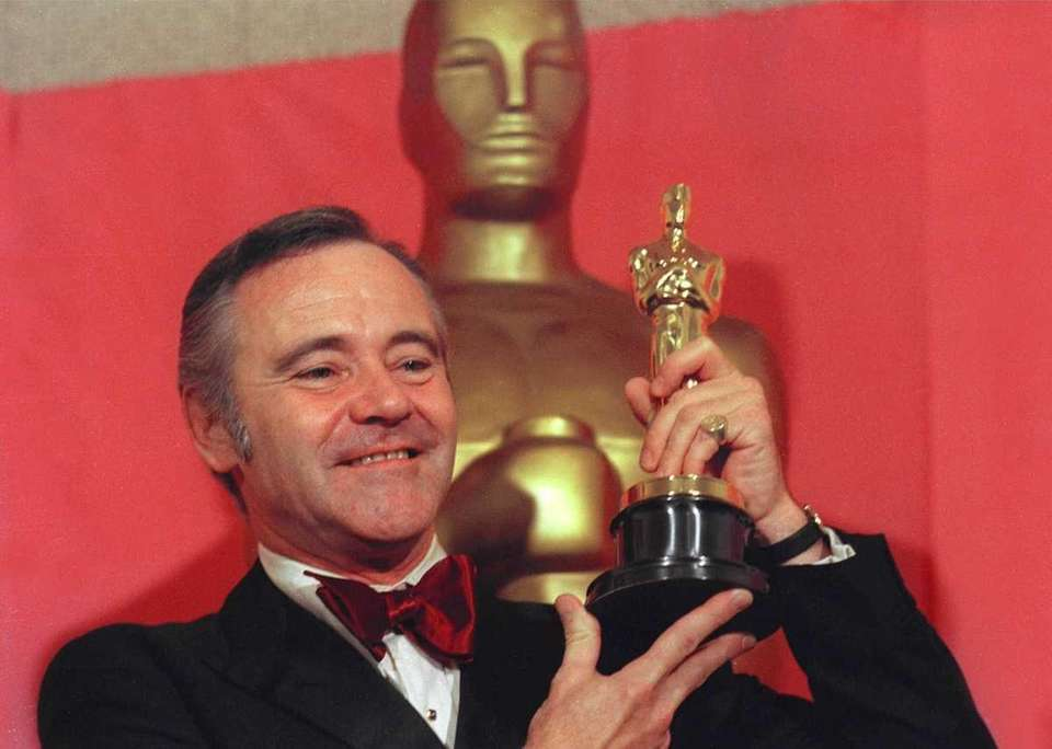 Actor Jack Lemmon, shown displaying his Oscar statuette,