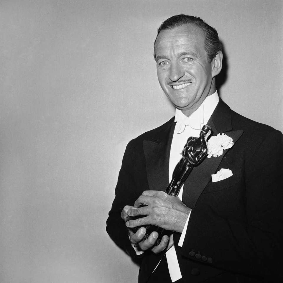 Actor David Niven, shown holding the 1959 Academy