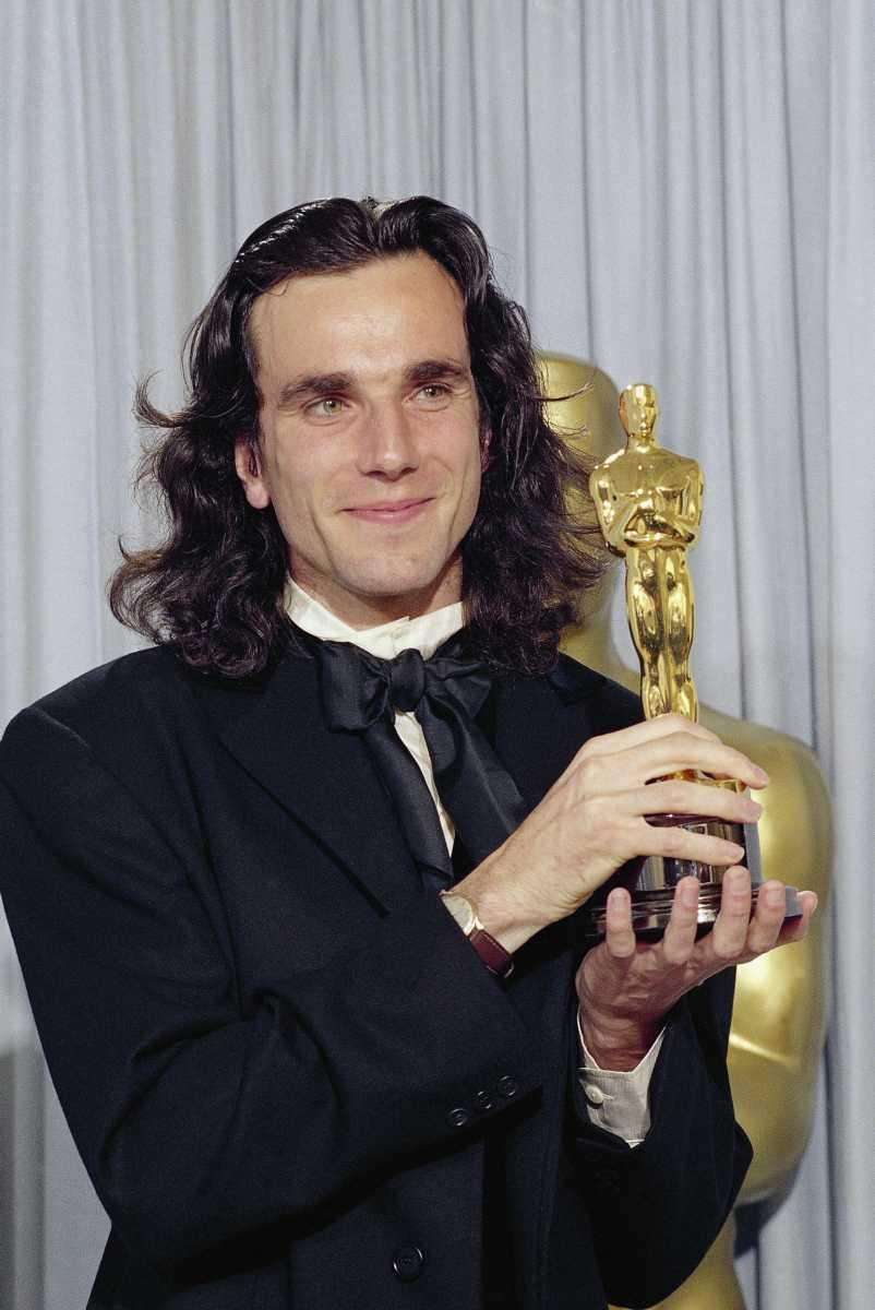 Actor Daniel Day Lewis holds his Oscar for