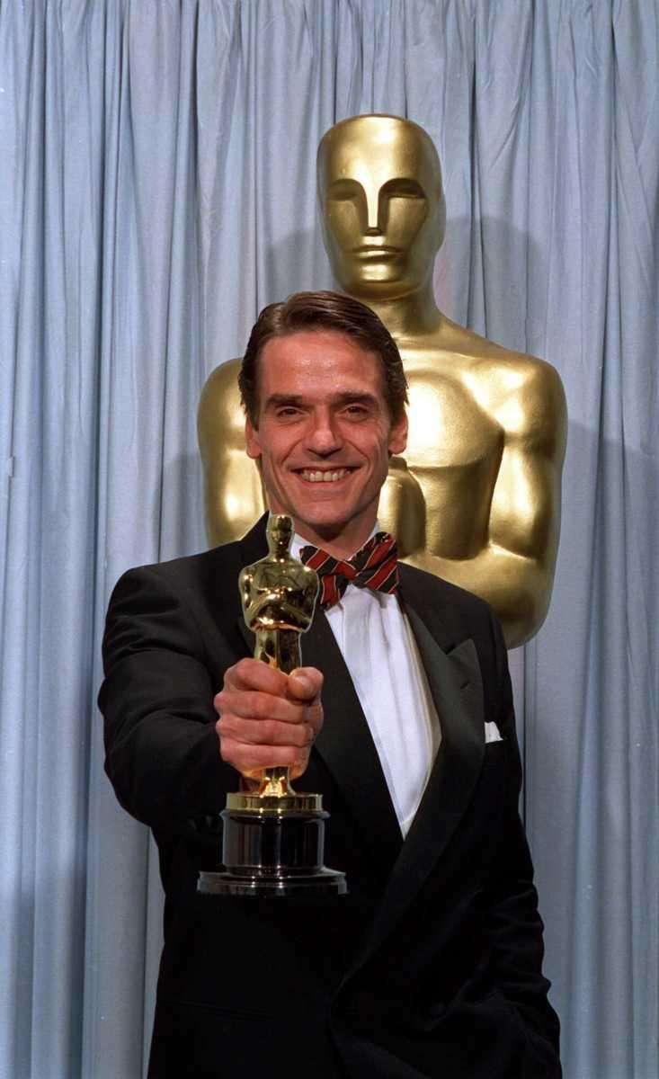 Actor Jeremy Irons, holding the Oscar statuette he