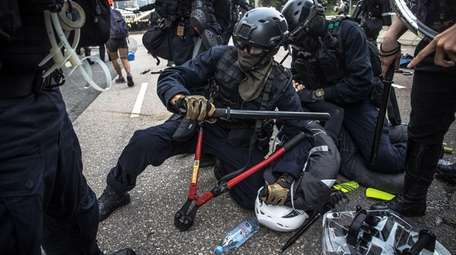 Riot police arrest a protester during an anti-government
