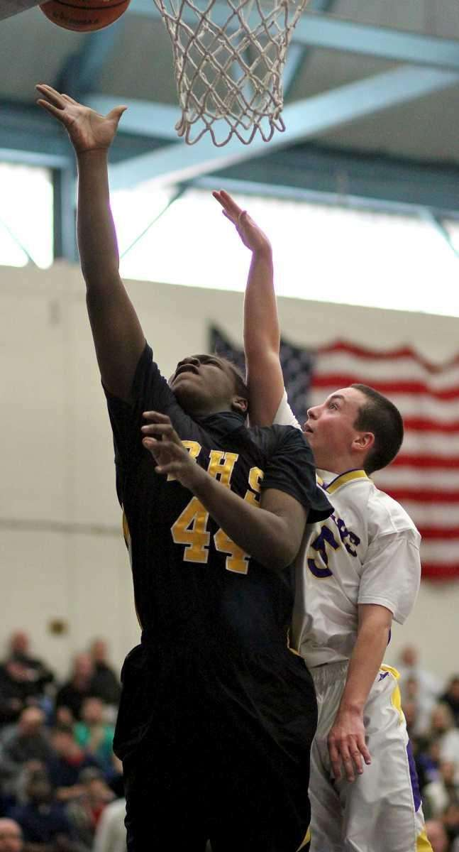 Bridgehampton's Josh Lamison #44 puts in the shot