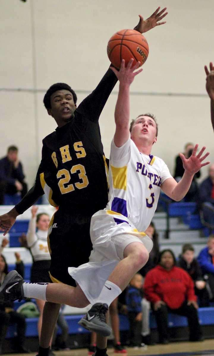 Greenport's Matthew Dibble goes baseline against Bridgehampton's Davion