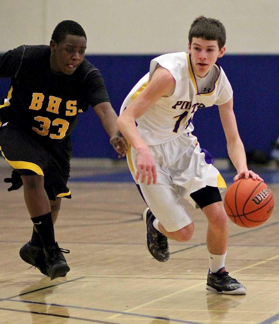 Greenport's Matthew Dibble #3 dribbles into the zone