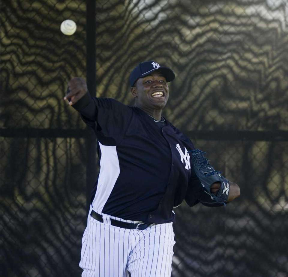 New York Yankees' pitcher Michael Pineda throws in