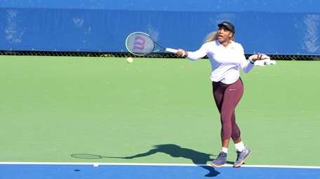 Serena Williams practices during U.S. Open Kids' Day