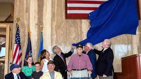 From left, World War II veterans David Wolman,