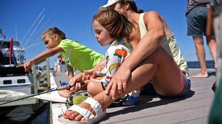 Annie Barrett of Brooklyn helps her children Lucia