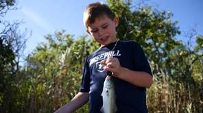 Austin Bilella, 7, of Patchogue, proudly holds his