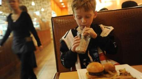 Dylan Shannon, 5, lingers over his meal at