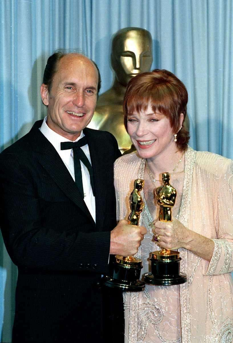 Actors Robert Duvall and Shirley MacLaine, posing backstage
