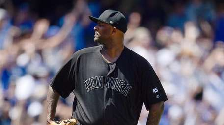 Yankees starting pitcher CC Sabathia reacts after giving