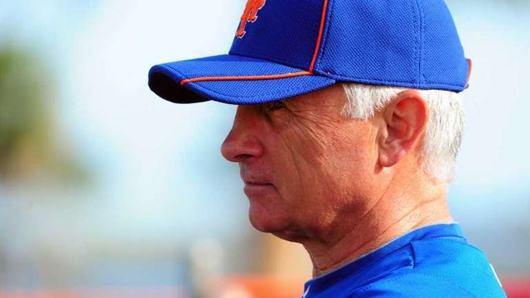 Mets manager Terry Collins watches as pitchers and