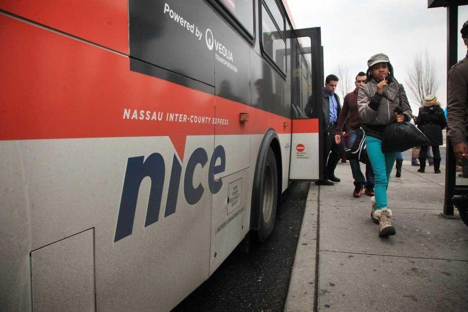 Riders exit a NICE bus (Feb. 15, 2012)