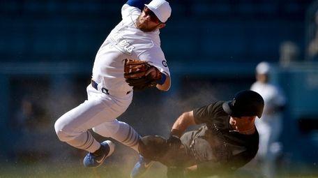 Los Angeles Dodgers second baseman Max Muncy falls