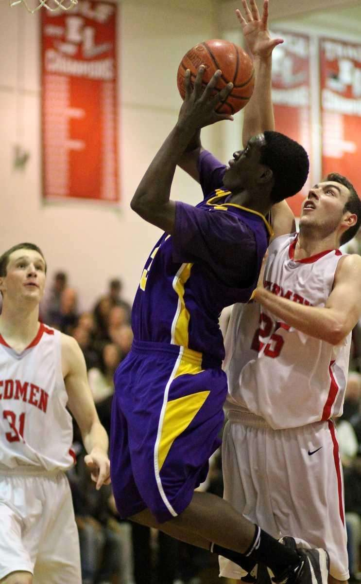 Central Islip's Jasean Percell #23 puts up the