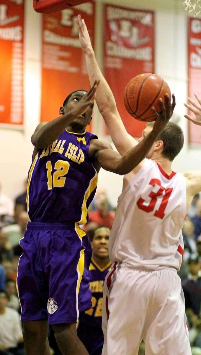 Central Islip's Timothy McKenzie goes baseline for two