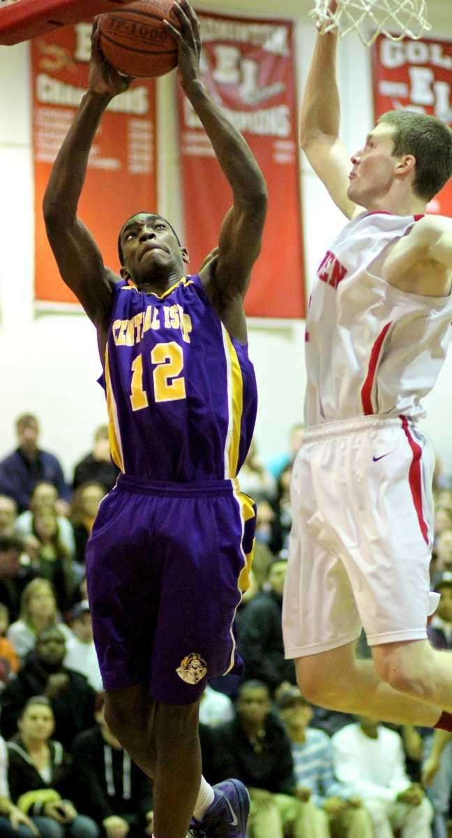 Central Islip's Timothy McKenzie #12 drives the baseline