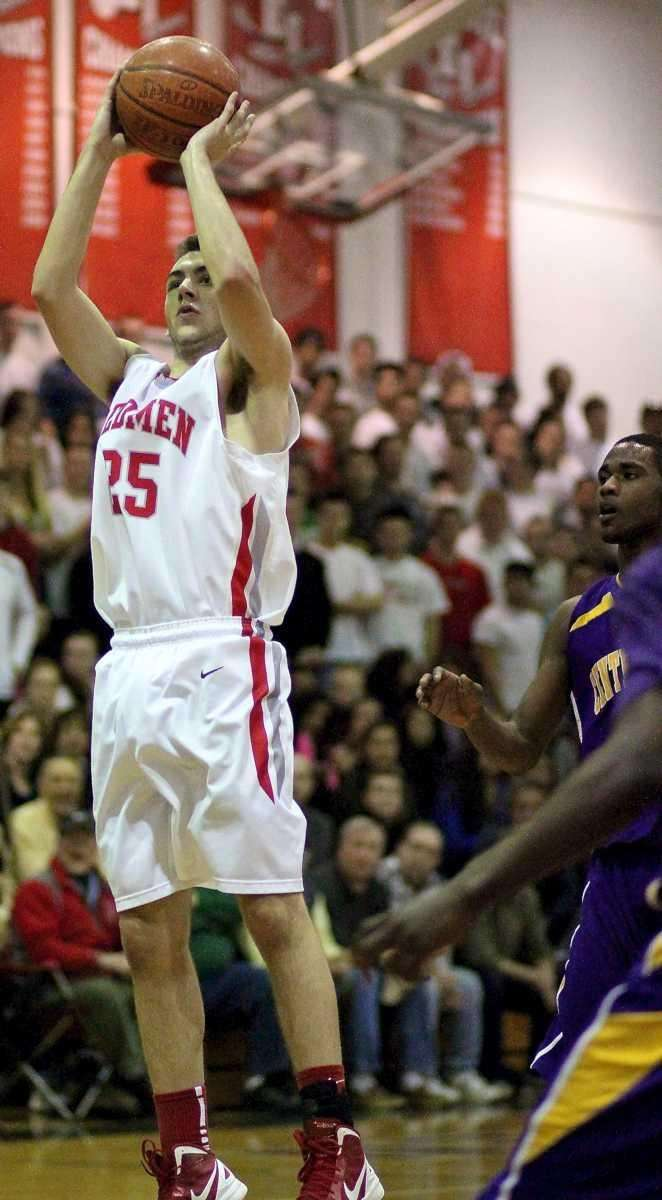 East Islip's Brian Bennett #25 puts up the