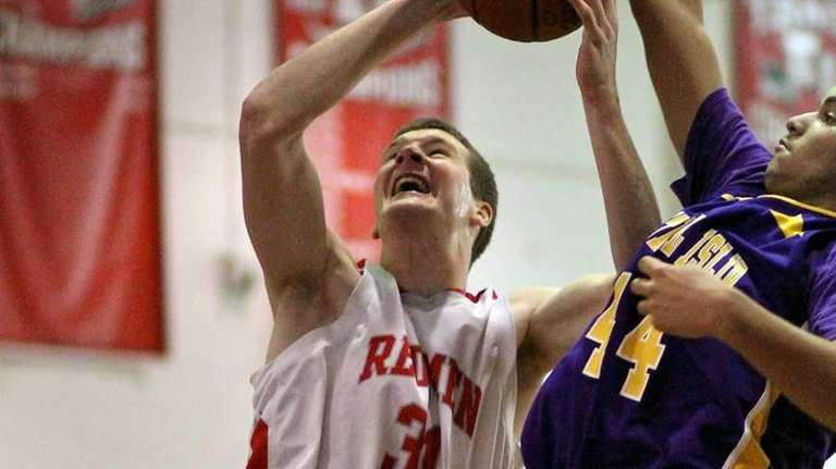 East Islip's Evan Maxwell #31 goes for the