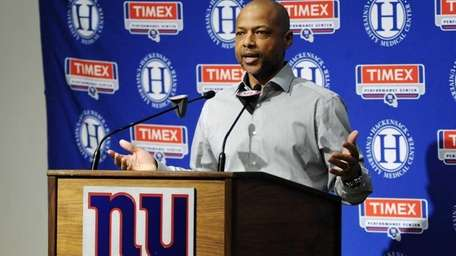Giants general manager Jerry Reese talks to reporters.