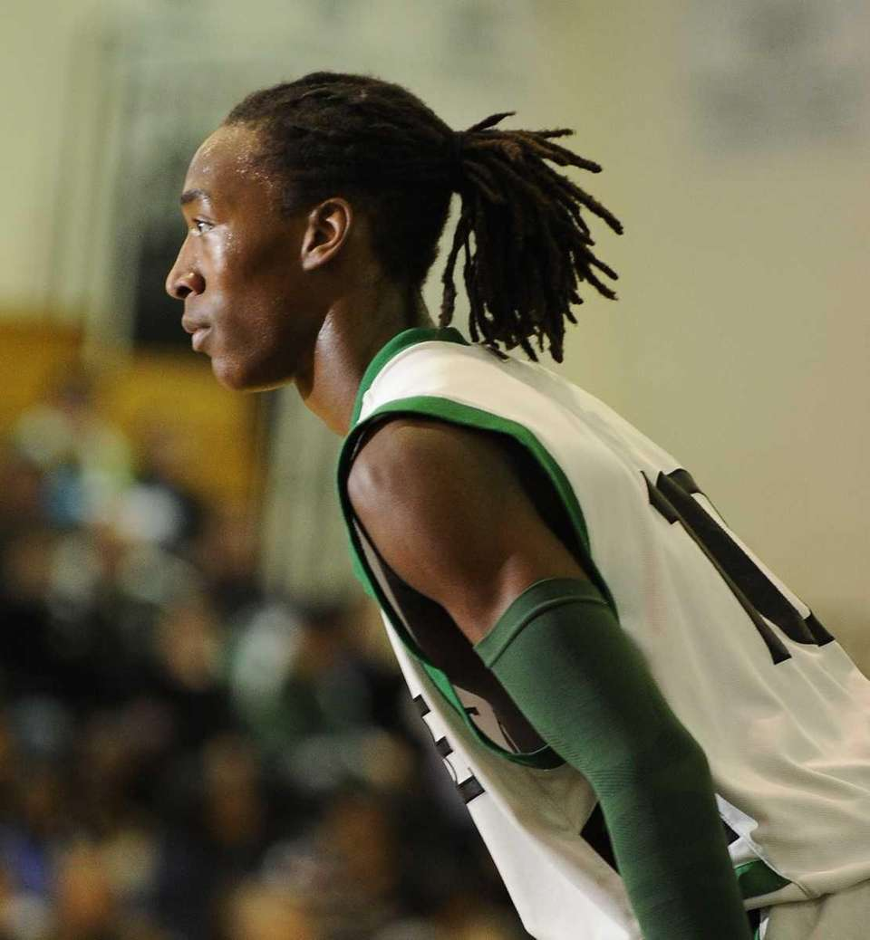 Farmingdale's Curtis Jenkins looks for a pass during