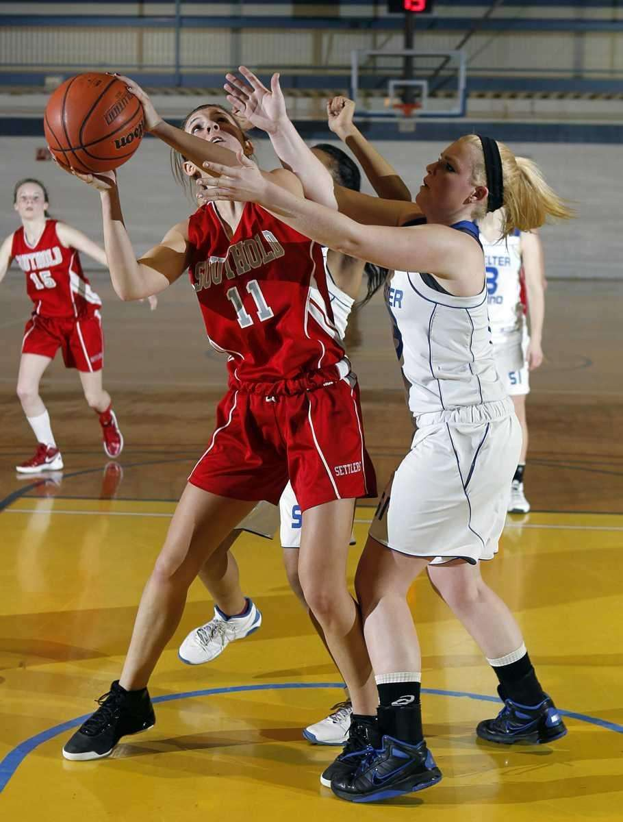 Southold's Nicole Busso (11) puts in the rebound