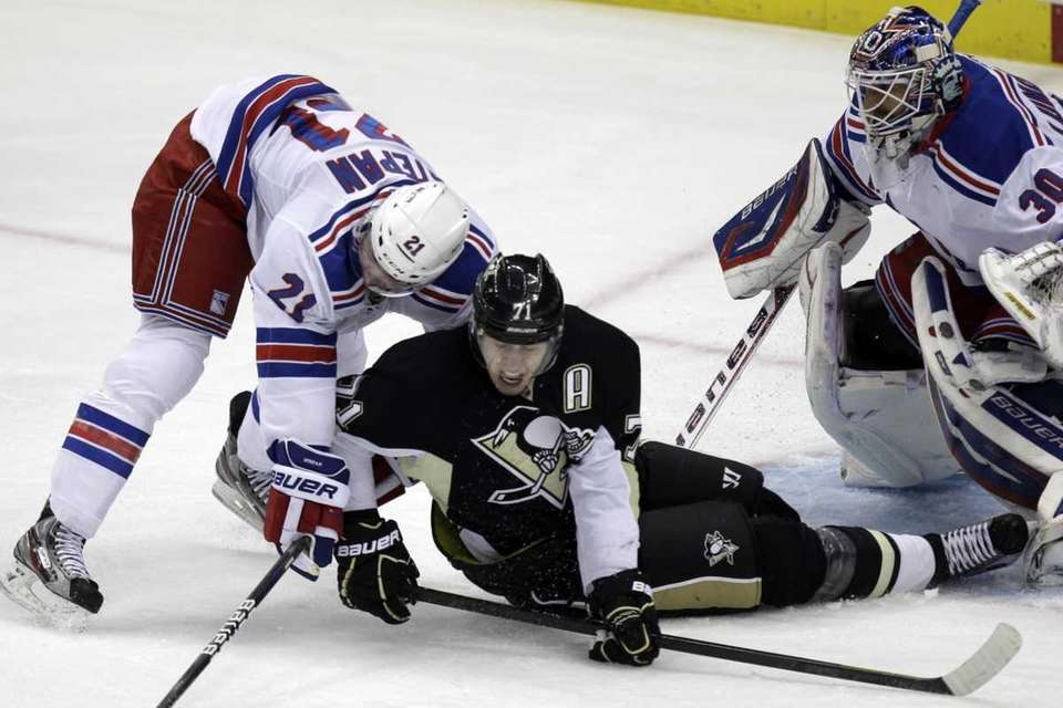 Pittsburgh Penguins' Evgeni Malkin collides with New York