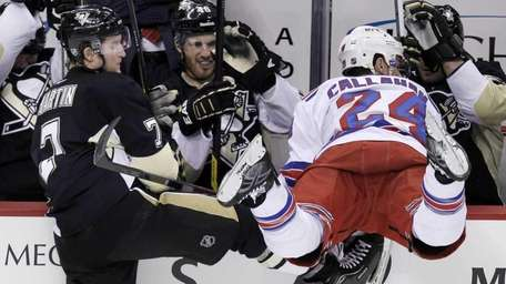 Pittsburgh Penguins' Paul Martin (7) collides with New