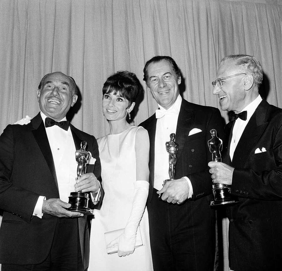 (L-R:) Jack Warner, Audrey Hepburn, Rex Harrison and