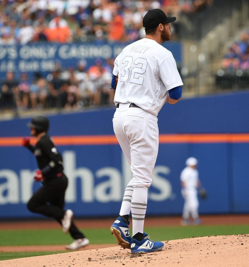 Mets starting pitcher Steven Matz stands on the