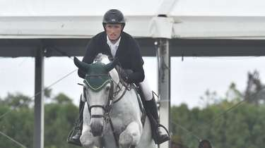 Richie Moloney clears the fence during a jumper