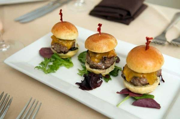 A platter of grilled sirloin sliders with aged