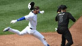 Mets second baseman Jeff McNeil is out at