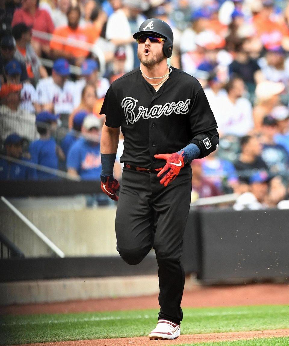 The Braves' Josh Donaldson reacts as he runs