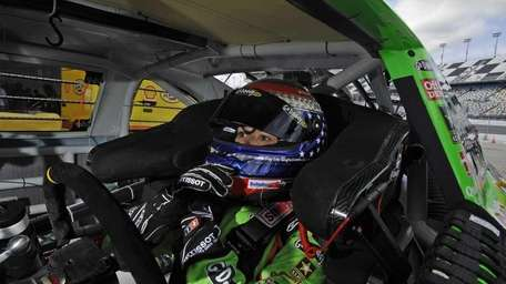 Danica Patrick sits in her car before practice