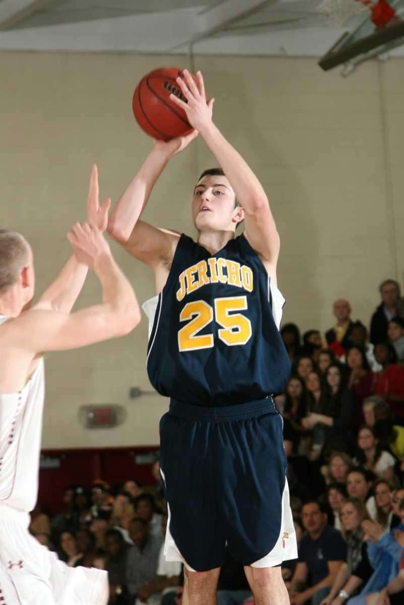 Jericho's Garrett Johnson scores two points during his