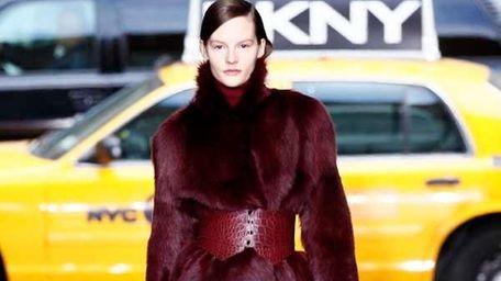 A model walks the runway at the DKNY