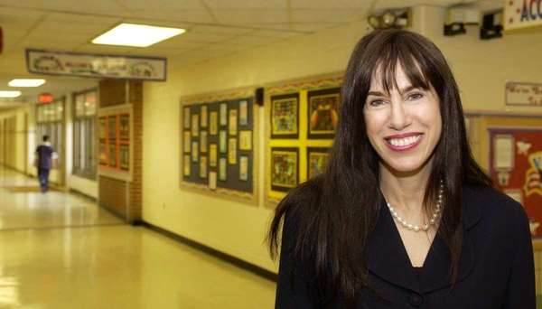 Dr. Carole G. Hankin, Superintendent of Schools, walks