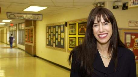 Dr. Carole G. Hankin, Superintendent of Schools, walks