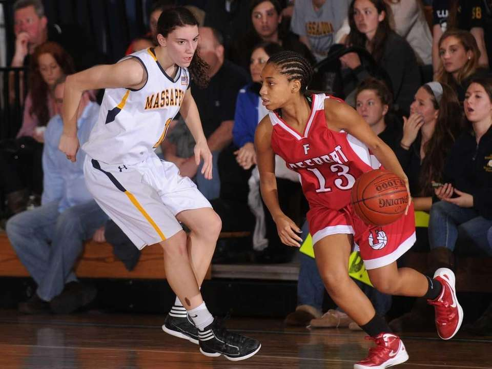 Massapequa's Morgan Roessler, left, guards Freeport's Aysha Harris