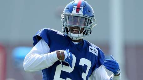 Giants defensive back Sam Beal signals to the
