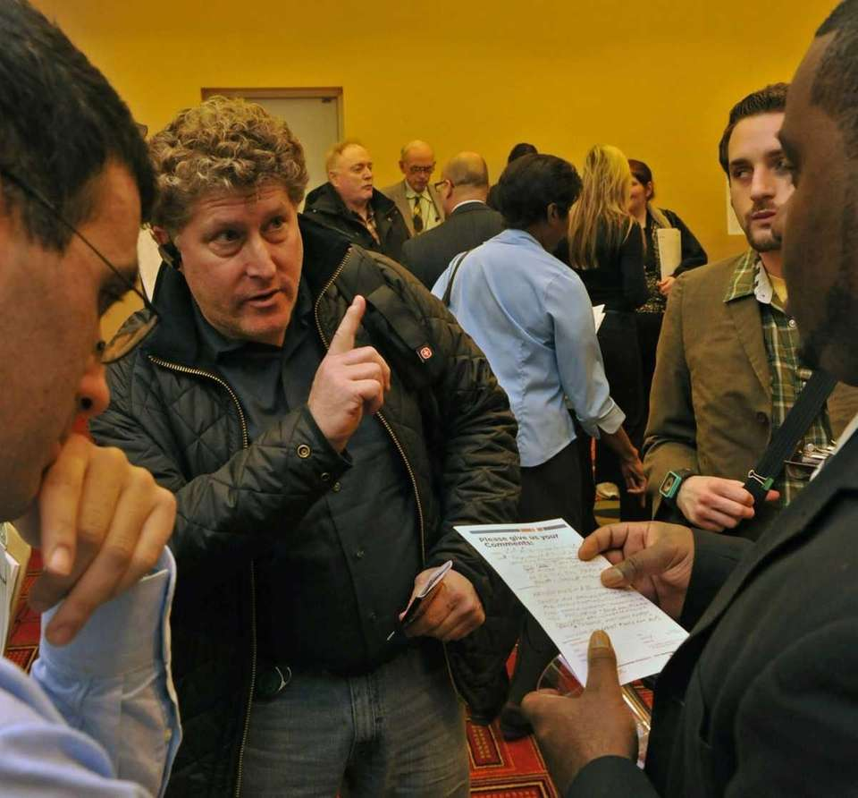 Alan Gershberg (52) from Valley Stream (center) is