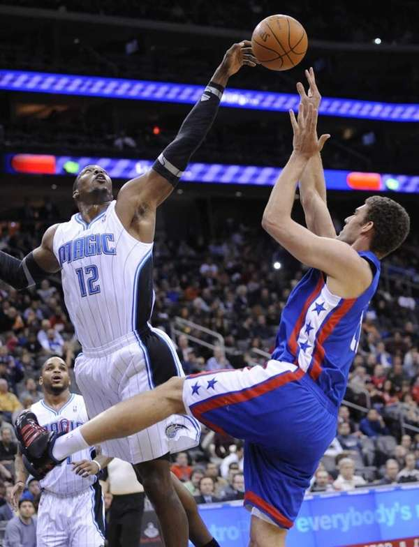 Orlando Magic center Dwight Howard, left, blocks a