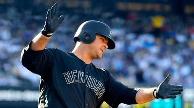 The Yankees' Mike Ford celebrates as he rounds